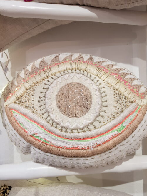 Embroidered cushion in the shape of an eye