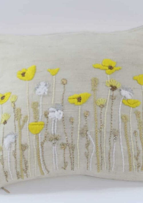 yellow poppy field embroidered onto a square cushion