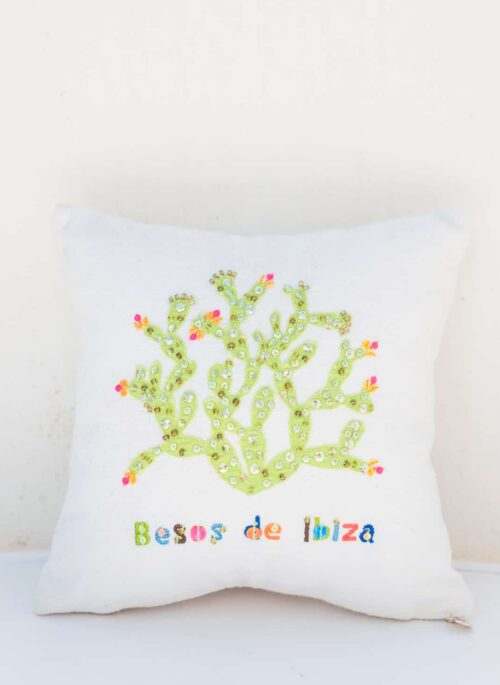 embroidered cactus with a besos de ibiza message on a cushion