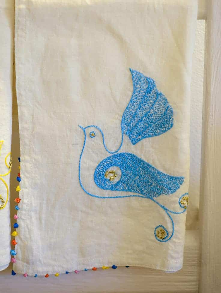 hand embroidered blue dove tea towel