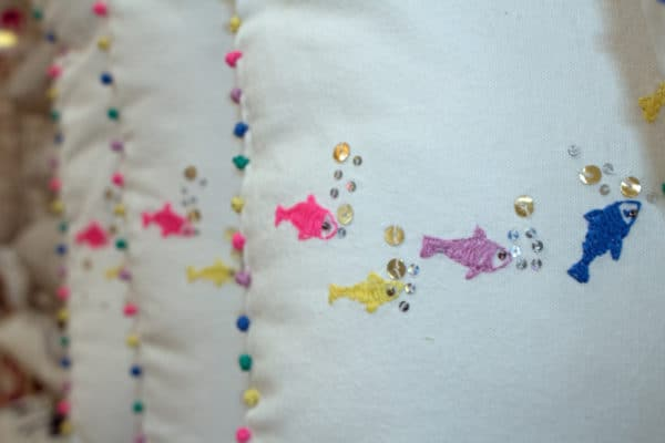 fish embroidery on white cushions