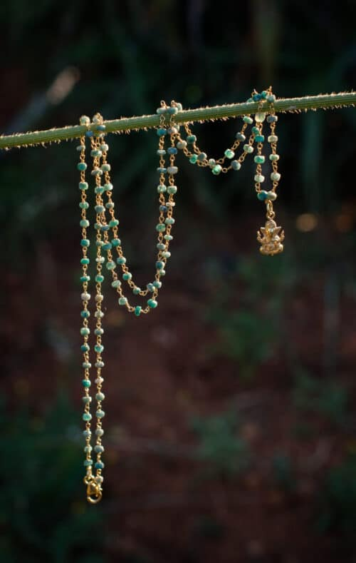 Emerald beaded necklace with charm
