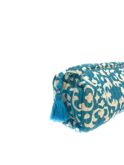 close up of a blue and white block printed make-up bag