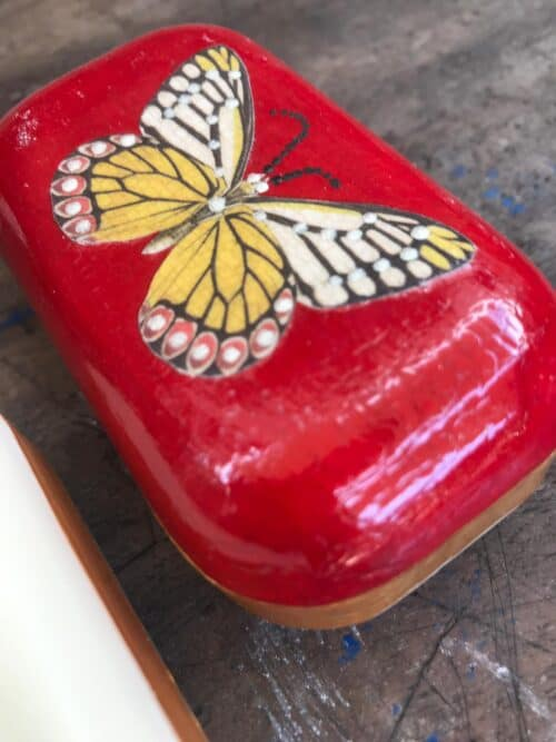 butterfly on a red soap decoupage