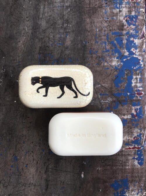 decoupage soap with a black puma on it