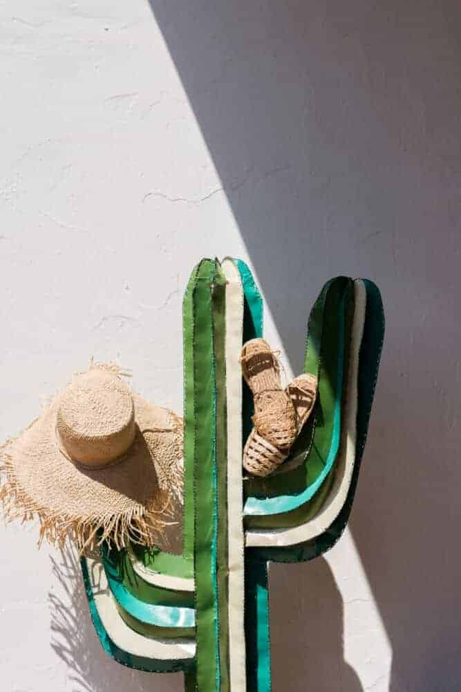 frayed straw hat from Madagascar with string sandals from Ibiza