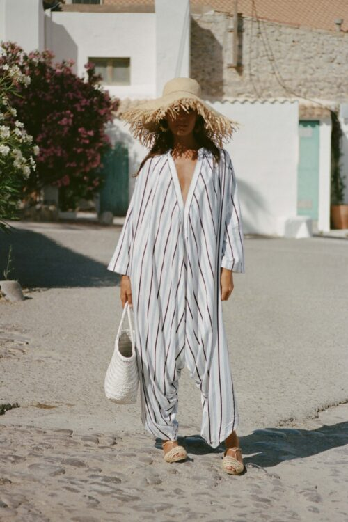 white leather bag with a white striped jumpsuit