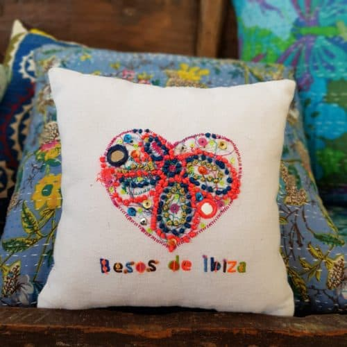 embroidered heart on a square cushion