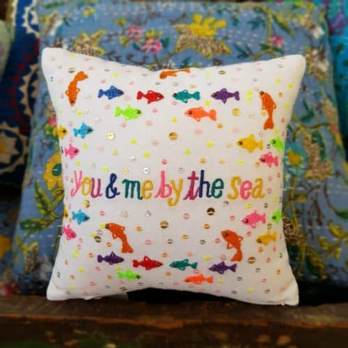 you and me by the sea embroidered on a cushion with fish